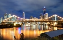 view on interesting modern bridge at night with city skyline in the background (story bridge,brisbane,que ensland,australia) © Pawel Papis