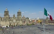 the zocalo in mexico city, with the cathedral and giant flag in the centre © dubassy