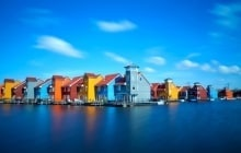 colorful buildings at Reitdiephaven on water in Groningen, Netherlands © catolla